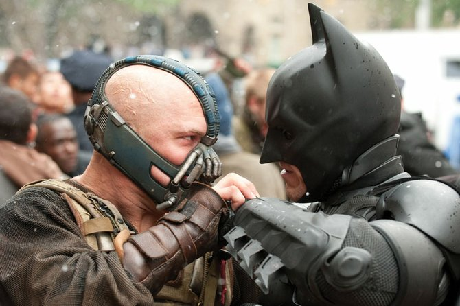 "Batman (Christian Bale) goes head to head with Bane (Tom Hardy) in ""The Dark Knight Rises."" The movie is the third and final entry in director Christopher Nolan's Batman trilogy."
