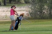 Caitlin Harjes hits an approach shot Tuesday on the ninth hole at Yampa Valley Golf Course. Harjes shot a 99 at the Yampa River Junior Classic and won the girls 15-17 age group.