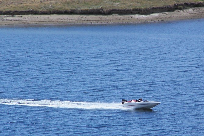 Water levels have dropped a little at Elkhead Reservoir, but it has not been enough to keep recreational users off the water. Boat traffic was good throughout July, according to Elkhead boat inspectors. Here, a boater kicks off August Wednesday at Elkhead.
