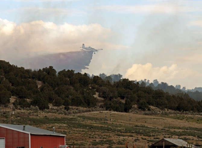 A single-engine air tanker drops fire retardant Wednesday on the Sugar Fire, a wildfire that burned five acres of Bureau of Land Management land about 20 miles west of Craig. The Sugar Fire was ignited by a lightning strike about 3:15 p.m. Wednesday. It was reportedly contained at 10:45 a.m. Thursday.