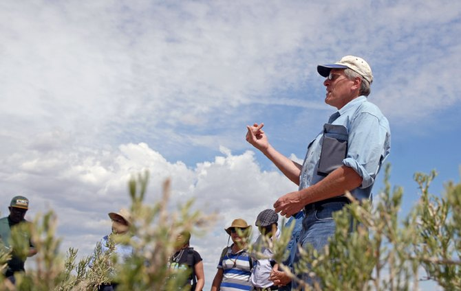 Jim Wurz, a faculty member with Colorado State University, leads a discussion on multiple use lands Wednesday on a private ranch near Cross Mountain. The Bureau of Land Management's Little Snake Field Office is in negotiations to buy the 900-acre property.