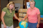 Sunset Elementary School teachers Melany Neton, left, and Cheryl Arnett point to the Czech Republic on a globe in Arnetts classroom. In November, the two will attend the Microsoft Partners in Learning 2012 Global Forum in Prague, an honor they earned after attending the U.S. event from July 31 to Aug. 1 in Redmond, Wash.