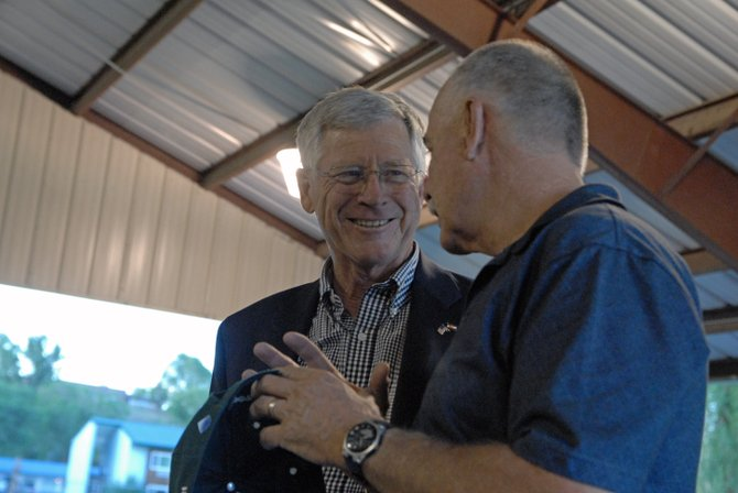 Bob Rankin, left, a Republican candidate for Colorado House District 57, chats with Craig City Council member Ray Beck on Thursday during a barbecue event hosted by the Bears Ears Tea Party Patriots.