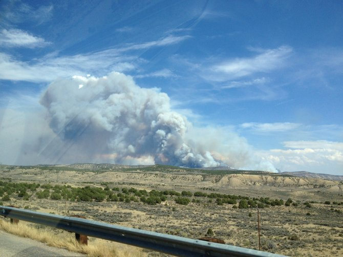 A fire burns Friday about five miles south of Elk Springs off U.S. Highway 40 in western Moffat County. The fire had grown to an estimated 1,200 acres by Saturday morning. 
