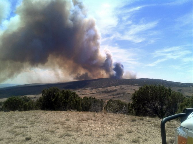 A view of the Wolf Fire, a 6,100-acre blaze actively burning in Moffat County about five miles south of Elk Springs. Steep, rugged terrain on the fire's southern perimeter has slowed firefighting efforts. The Wolf Fire is reportedly 40-percent contained.