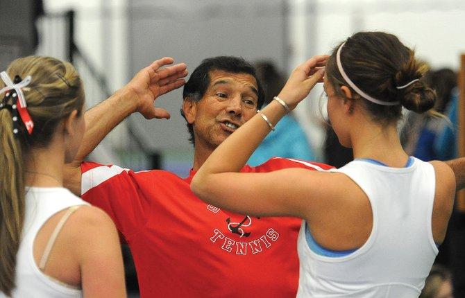 Steamboat coach John Aragon passes some advice along to Brooke Metzler and Summer Smalley last spring during the girls tennis season. Aragon will continue to coach the girls this season but has elected to step down as the boys head coach in order to take a trip with his wife.