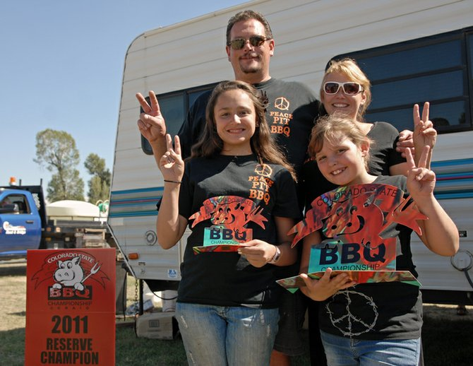 Peace Pit BBQ, of Greeley, improved over last year's reserve champion finish to take top honors in the 2012 Colorado State BBQ Championship at Craig. Pictured here, clockwise, are Mark, Susan, Destiny and Mary Jo Shook.