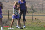 Emma Jones, 8, works on her swing at the driving range at Yampa Valley Golf Course. Jones was one of 12 girls to participate in the Ladies Professional Golf Association Girls Golf Day at the course. Each participant received instruction from Moffat County High School coaches and players, as well as a gift at the end of the two-hour session Wednesday.