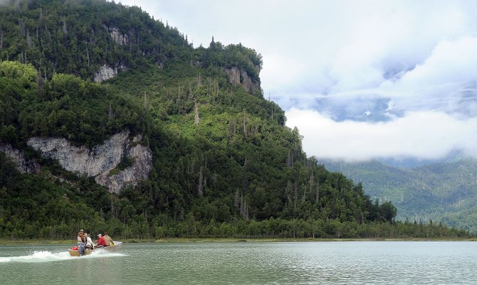 A fishing boat flies across Alaska's Big River Lake on Tuesday. High Adventure Charters is one of several outfitters to offer fly-in fishing and bear viewing trips to the secluded lake.