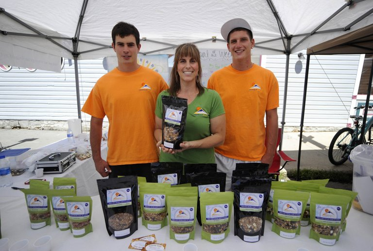 Mitch Lekarczyk, left, and his younger brother, Michael Lekarczyk, have been helping their mother, Diane Lekarczyk, with her Granola Gold business, which has gained a strong following at the Mainstreet Farmers Market.
