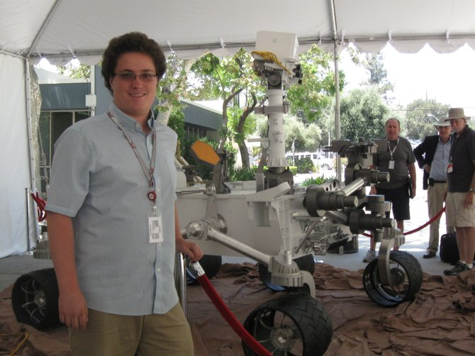 2008 Steamboat Springs High School graduate Dustin Buccino stands in front of a scale model of the Mars rover Curiosity. Buccino is interning for Jet Propulsion Laboratory and was able to get a firsthand look at the Mars rover Curiosity landing early Monday.