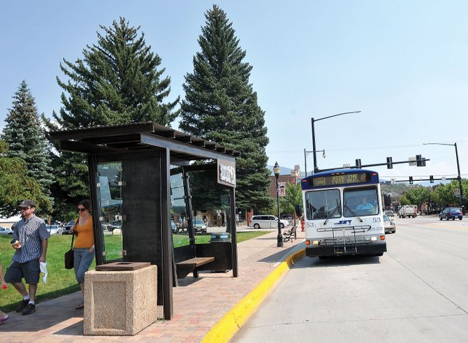 A Steamboat Springs City bus pulls into the Fifth Street stop Tuesday afternoon. The downtown bus shelter project was named Best Public Space Project by nonprofit Downtown Colorado Inc.