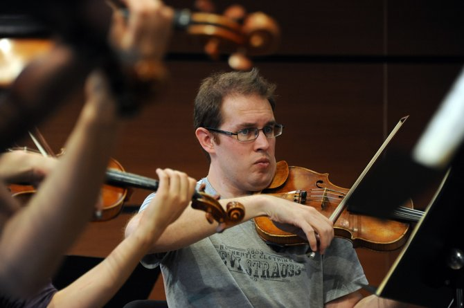 Adam Jordan rehearses with the Steamboat Symphony Orchestra on Thursday at Strings Music Pavilion. The orchestra opens its 21st season Saturday with music from John Williams and Sibelius.