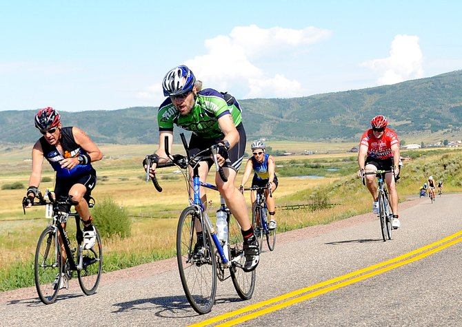 Mark Sheel, in green, leads a pack of riders during last year's Steamboat Triathlon. The 2012 triathlon kicks off at 8 a.m. Sunday.
