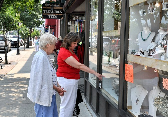 Arlene and Sharon Hart window shop Friday afternoon along Lincoln Avenue in Steamboat Springs. Downtown business owners have a wide range of opinions about the proposal to add a casino in Hayden, and some question its reach beyond western Routt County.
