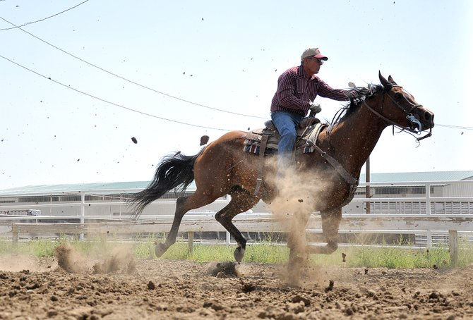Dick Williams races his horse Sunday at the Routt County Fairgrounds in Hayden during the closing day of the Routt County Fair.