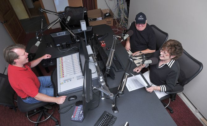 Brian Harvey, manager of KEZZ 94.1 FM, laughs with Nancy and Verne Lundquist while working to produce public service announcements for the $10K Day for United Way.