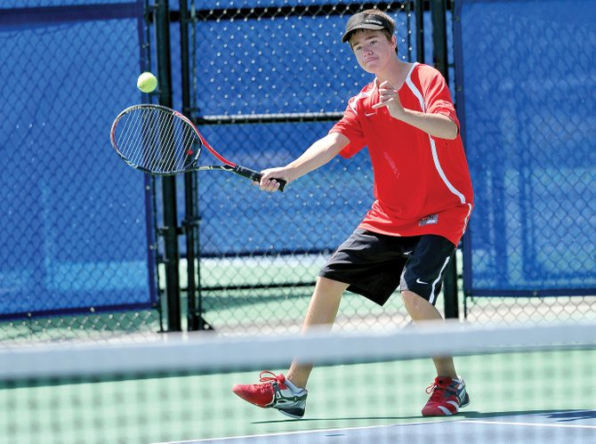 Steamboat Springs No. 3 singles player Corbin Diehl returns a shot during a match against Boulder on Friday afternoon at the Tennis Center at Steamboat Springs.