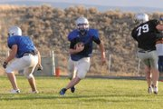 Moffat County High School senior quarterback Bubba Ivers looks to cut up field during a scrimmage against Coal Ridge High School at the Bulldog Proving Grounds Friday. Ivers and the Bulldogs new offensive sets looked sharp, as they scored on their first three possessions.