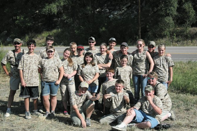 The Moffat County 4-H Club Sliver Slingers archery team poses at the Colorado State Archery Shoot in Pueblo Aug. 19. The team had it's best year ever at the competition, winning the junior compound bow unlimited division, coming in third in the senior compound bow unlimited division, and fifth in the junior compound bow limited division.