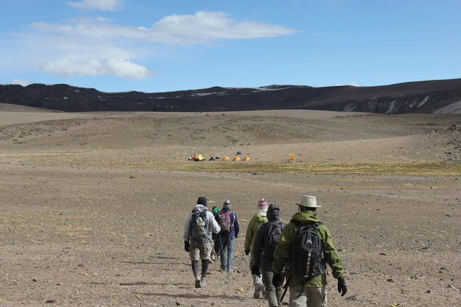 The expedition team approaches Camp 1 at 16,200 feet after crossing the Continental Divide of the Andes.