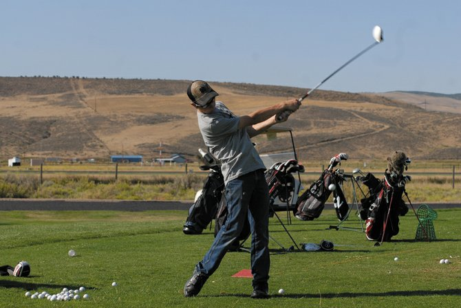 Moffat County High School sophomore Casey Nations hits from the Yampa Valley Golf Course driving range this summer. Nations shot a career-best 87 at Tiara Rado Golf Course in Grand Junction Tuesday and has emerged as the Bulldogs' top player.