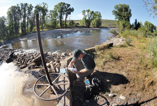 Water Commissioner Brain Romig checks a head gate for an irrigation ditch on the lower Elk River. Water commissioners shut down a number of irrigation pumps and head gates along the Elk River north of Steamboat Springs as it invoked a state law that protects baseline flows. Commissioners now will take a look at Yampa River head gates to protect flows in that river.