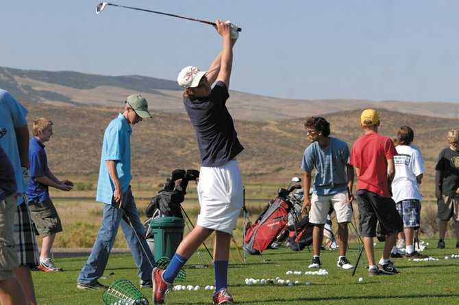Chris Jones, a junior at Moffat County High School, hits from the driving range at Yampa Valley Golf Course during practice this summer. Jones is an upperclassman on a young golf team this season, one which coach Casey Kilpatrick says he is excited to work with.