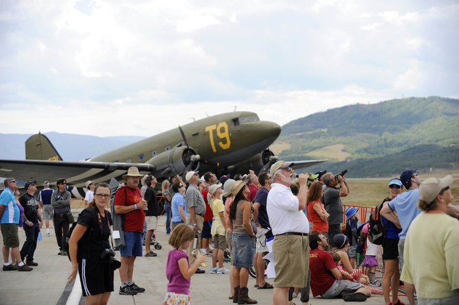 Wild West Air Fest emcee Mike Forney and spectators watch the remote-controlled airplane show Saturday at Steamboat Springs Airport. The event continues from 9 a.m to 3 p.m. Sunday.