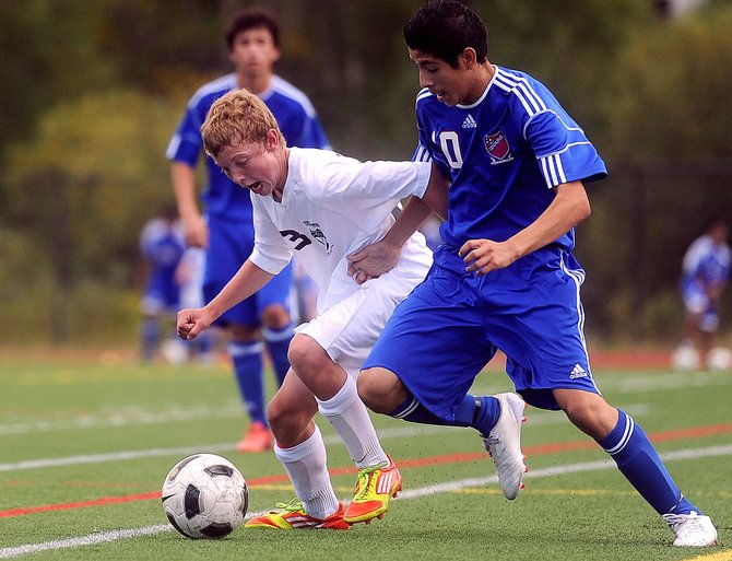 Steamboats Charlie Beurskens fights for a ball Saturday in the Sailors 2-0 victory against Centaurus. 
