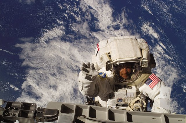 Astronaut Steven Swanson waves for the camera as he and fellow spacewalker Patrick Forrester work during a spacewalk June 13, 2007. Swanson said he was apprehensive before his first spacewalk, but once he was out and on top of the station, the view and experiences were surreal. 
