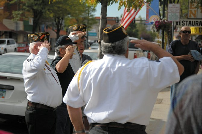 Members of the American Legion, VFW and citizens of Craig give the pledge of the allegiance to the American flag in Alice Pleasant Park Monday morning. The flag had just been raised as part of a dedication ceremony to increase unity and improve social events in downtown Craig.