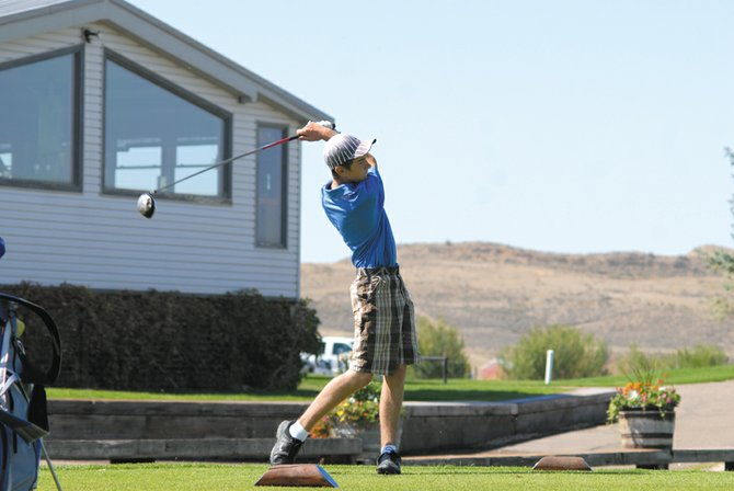 Moffat County High School sophomore Casey Nations tees off the 10th hole at Yampa Valley Golf Course. Nations and the Bulldogs were playing at their home tournament against 12 other high school teams Wednesday.