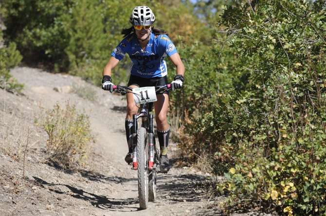 Steamboat Springs rider Mindy Mulliken rips down Emerald Mountain on Saturday at the Ride For Dirt fundraiser. Mulliken won the women's 25-mile ride.