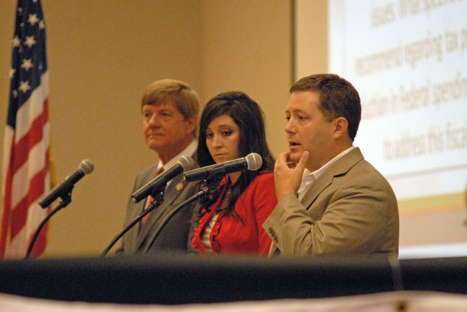 Sal Pace, from right, Tisha Casida and Scott Tipton, discuss issues Saturday night during a Club 20 debate at Colorado Mesa University in Grand Junction for the Office of 3rd Congressional District of Colorado.