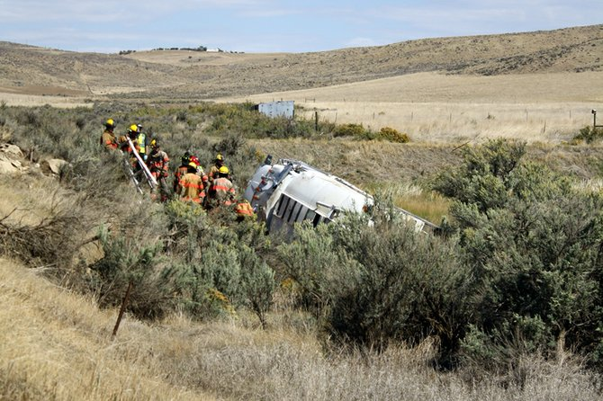 A Moffat County road and bridge water truck rests on its side Monday after it rolled off county road 64. The operator of the truck, a county employee, had to be extracted from the cab by Craig Fire/Rescue firefighters, but did not sustain serious injuries.