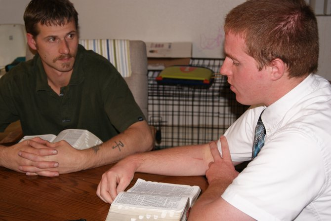 Ben Hawks, left, listens to Elder Smith, of the Church of Jesus Christ of Latter-day Saints' stake in Craig, during an appointment. Elder Smith is a missionary stationed in Colorado and currently serving the stake at Craig. Young men of the faith are encouraged to go on missions, lasting two years, in service to their faith.