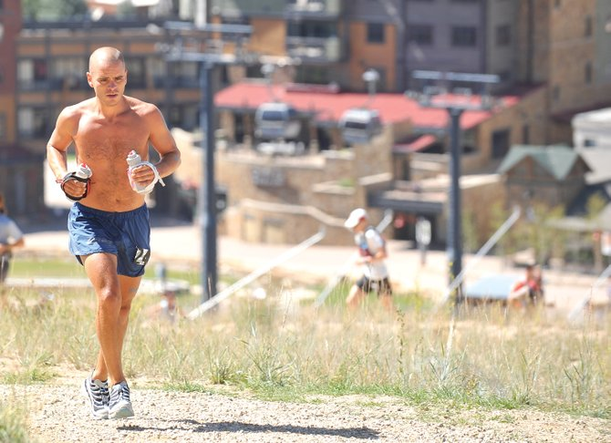 Arizona runner Dave James makes his way up the slopes of Mount Werner after the start of the hare division in the 100-mile Run Rabbit Run ultramarathon.