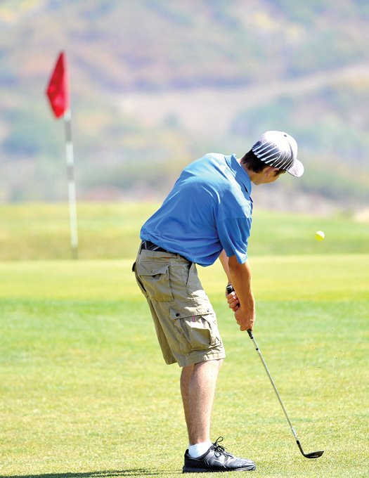 Moffat County golfer Casey Nations chips onto the green at the Haymaker Golf Course during Thursday's Steamboat Sailors Inivitational.