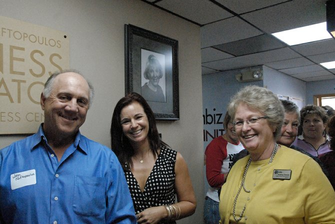 John Raftopoulos, left, Craig/Moffat Economic Development Partnership Director Betsy Nauman-Cook, center, and Moffat County Commissioner Audrey Danner pause for a picture Friday during the grand opening of The Marianna Raftopoulos Business Incubator and One Stop Business Center.