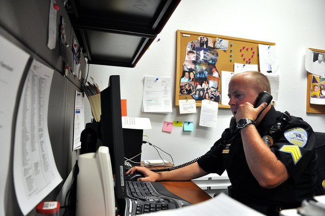 Police Sgt. John McCartin works Thursday afternoon at the Steamboat Springs Police Department headquarters on Yampa Street. The city is pursuing a plan to demolish the Iron Horse Inn and replace it with a 15,000-square-foot police station.