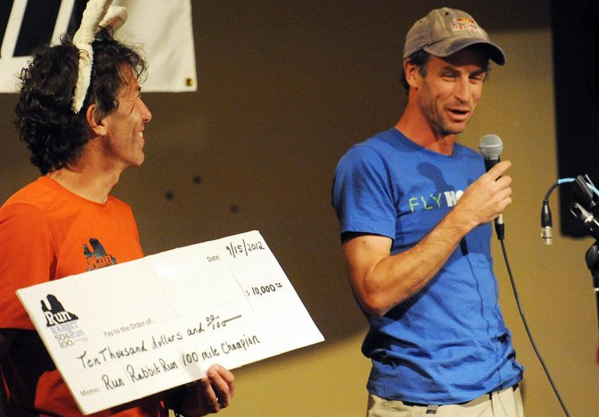 Karl Meltzer speaks at the awards ceremony after the Run Rabbit Run ultramarathon. He won the 100-mile race, his 33rd such title.