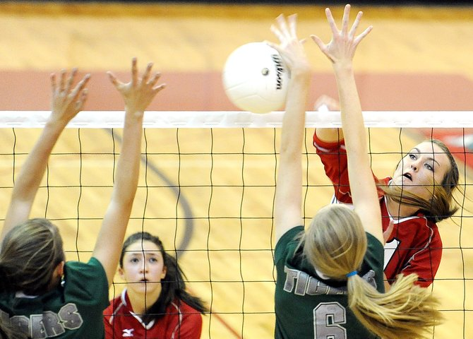Steamboat&#39;s Alex Feeley hammers a ball Saturday against Summit. The Sailors won their first home match, taking three games in a row against the Tigers.