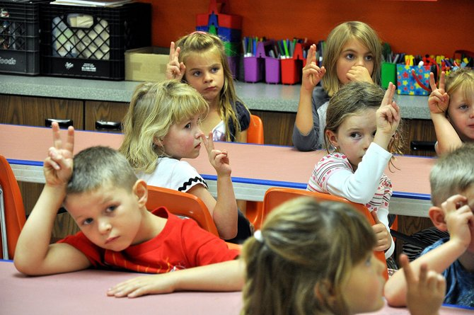 First-grade students at South Routt Elementary School on Aug. 22 put up peace signs during art class. The South Routt and Hayden school districts are projecting increased enrollment for the first time since 2008.