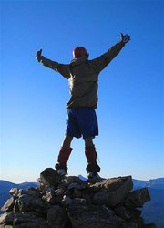 Jason Kawcak stands at the top of a mountain after completing a backpacking trip with the Bear River Young Life  Group his senior year of high school. A new mural on the Young Life building is based on the photo, a tribute to Kawcak who died in an accident at work last July. David Pressgrove, area leader for Young Life said the photo represents Kawcak embracing life.