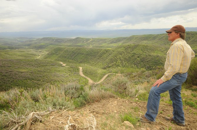 Brent Romick gazes out over Wolf Mountain Ranch. Romick confirmed Monday that the latest easement brings to 16,127 the number of conserved acres on the broad shouldered mountain about five miles east of Hayden and north of U.S. Highway 40.