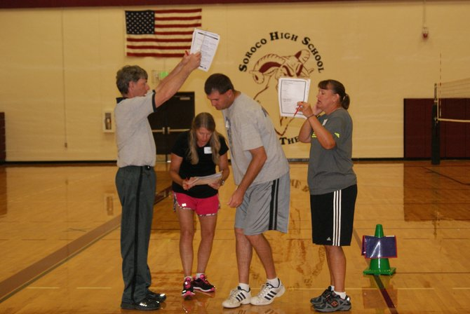 From left, Craig elementary school physical education teachers Tim Hurst, Susan Nicholson, Matt Ray and Karen Rohnke, learn to teach the Virgina Reel dance by doing it themselves as part of SPARK training. SPARK is the new physical education curriculum chosen by teachers of Moffat County and other area school districts. The new curriculum, along with new equipment, is funded by a grant from the Colorado Health Foundation.