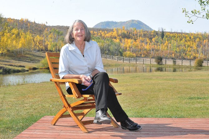 "Author Ann Stranahan sits on the deck of The Home Ranch just outside Clark in North Routt County. Stranahan will be talking about her book ""Window on the River"" at 5:30 p.m. Tuesday at Off the Beaten Path Bookstore."