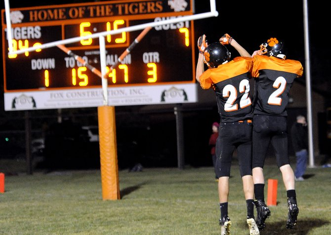 Hayden's Aaron Cramer and Mark Doolin celebrate a score Friday against Soroco. The Tigers won that game, 49-7, giving them the edge in the race to win the division. Hayden was ranked No. 7 in Monday's 8-man poll released by the Denver Post.
