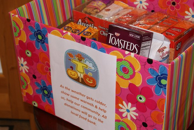 A donation box sits in the lobby of Yampa Valley Bank in Craig. Monday marked the start of local banks collecting donations of food and cash for the Inter-Faith Food Bank in Craig. As the holiday season approaches, the food bank is low on food and funds. Local banks will be accepting donations through October 5.